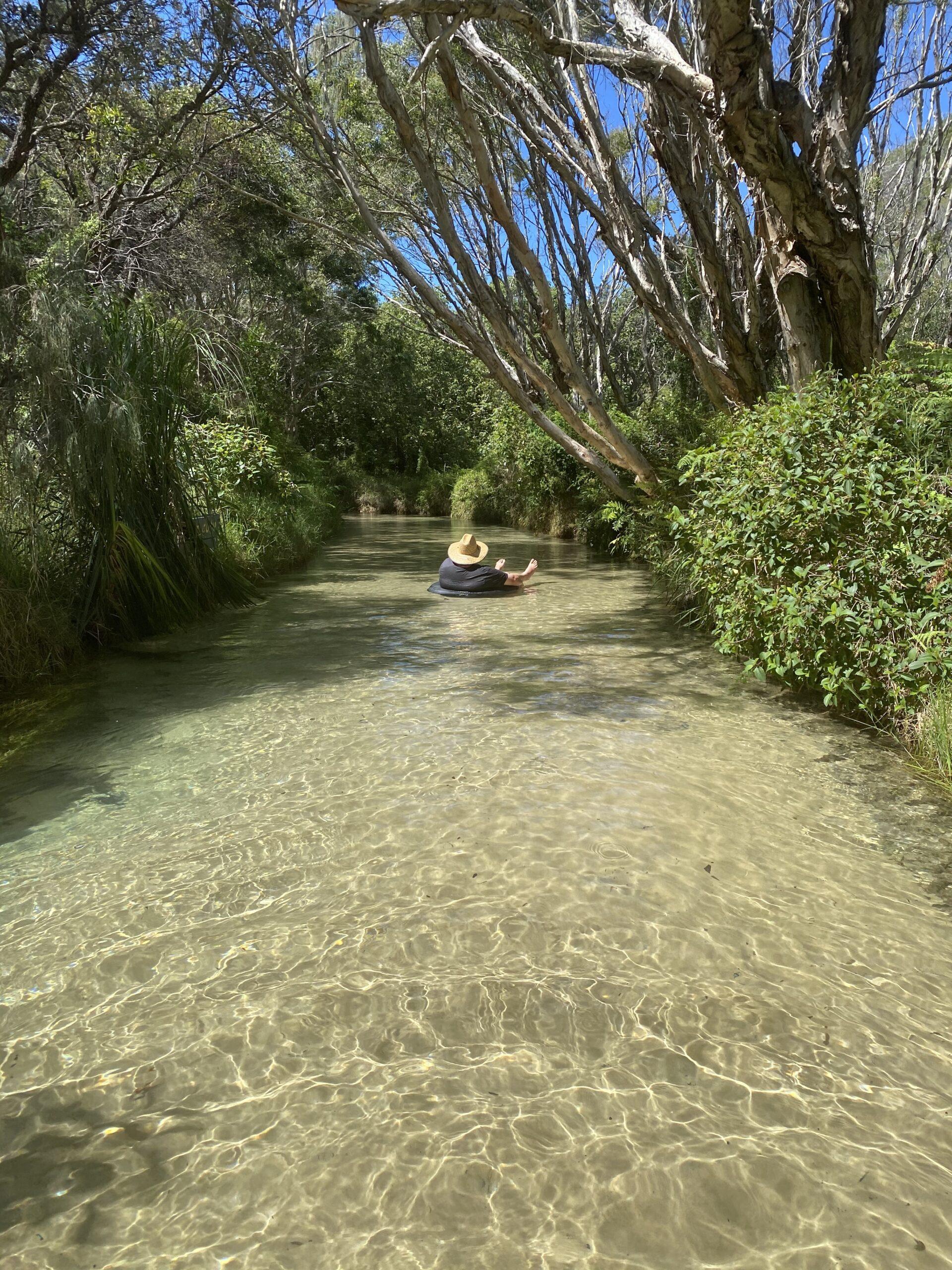 Enjoying the ride down Eli Creek, Fraser Island